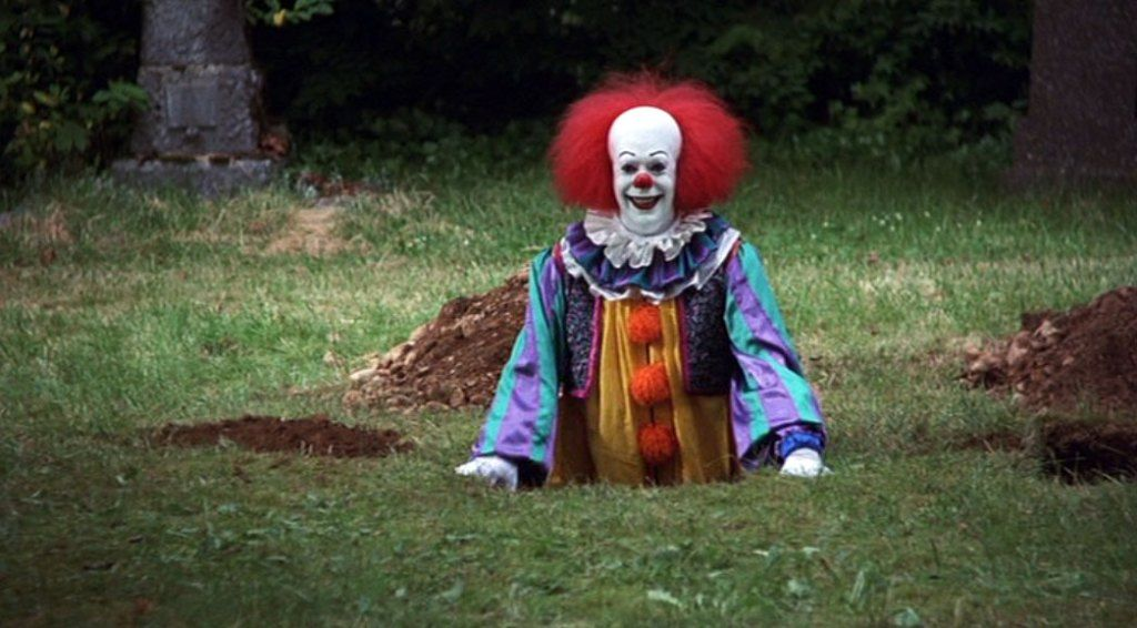 """Pennywise Lives: Tim Curry's Role in """"IT"""" Floats On In Our Nightmares"""