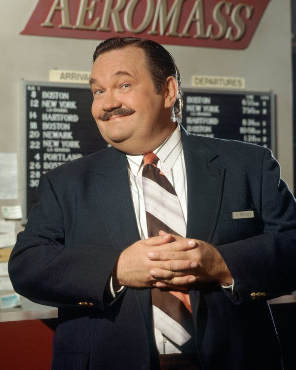 """David Schramm in a promotional photo for the long-running NBC sitcom """"Wings."""" He played the irascible owner of a small airline."""