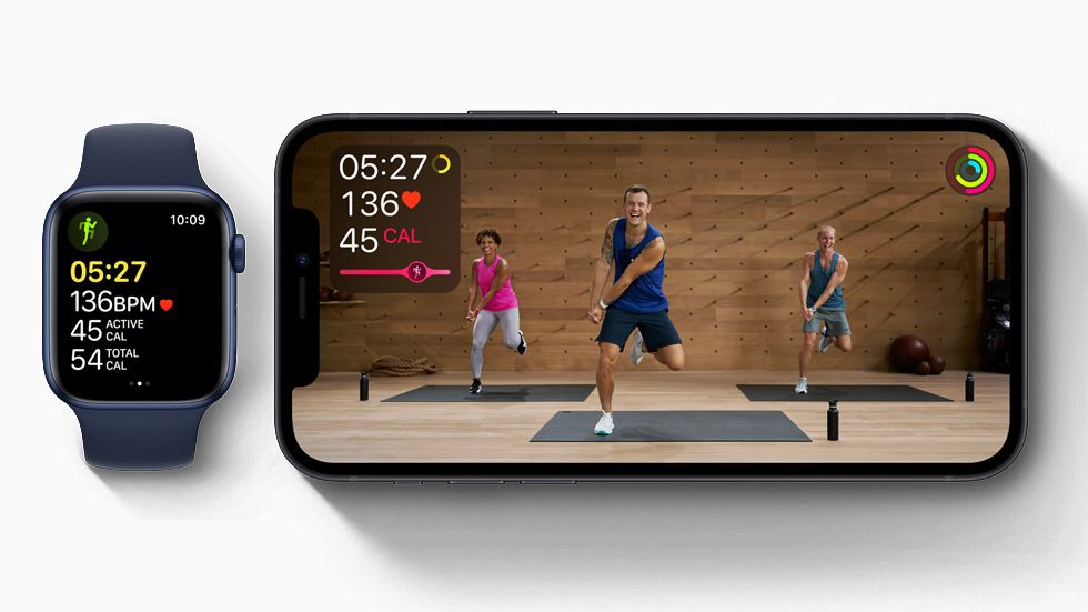 Apple Fitness + Studio workout displayed on iPhone 12, and workout in progress on Apple Watch Series 6.
