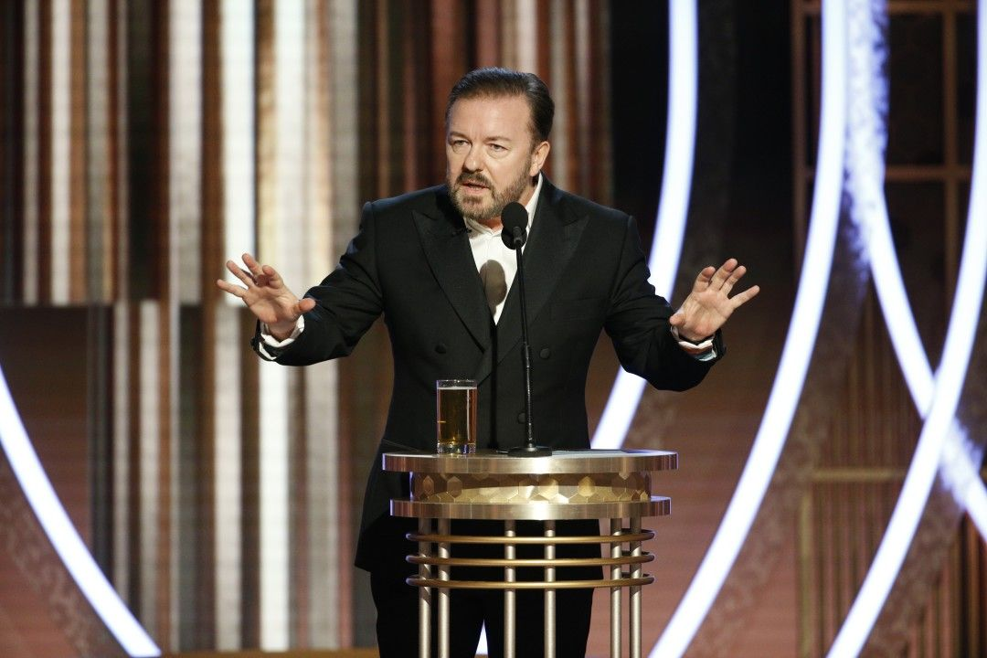 Host Ricky Gervais stands on stage at the Golden Globe Awards
