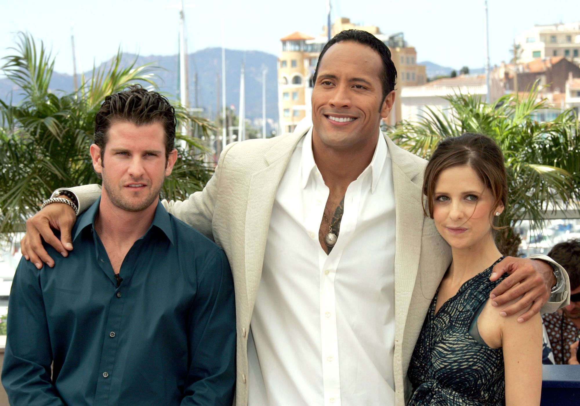 Image may contain Richard Kelly Human Person Clothing Apparel Dwayne Johnson Sarah Michelle Gellar Shirt and Suit