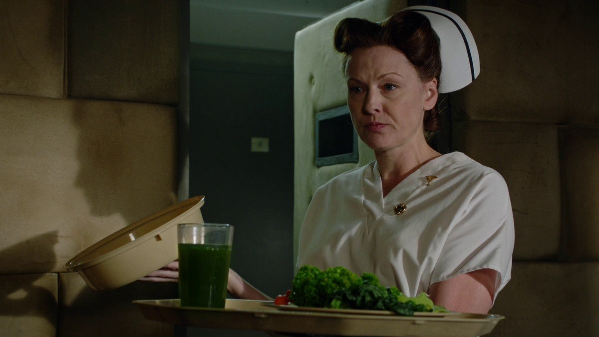 nurse ratched holding a plate of very bland and unseasoned vegetables