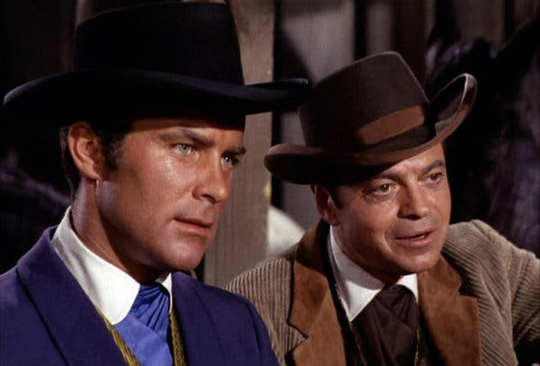 "Robert Conrad, left, as James T. West, with Ross Martin as Artemus Gordon in an episode of the TV series ""The Wild Wild West"" in 1966."