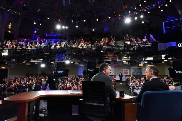 "Jake Tapper, right, an in-demand late-night guest, on a recent episode of ""The Late Show With Stephen Colbert."""