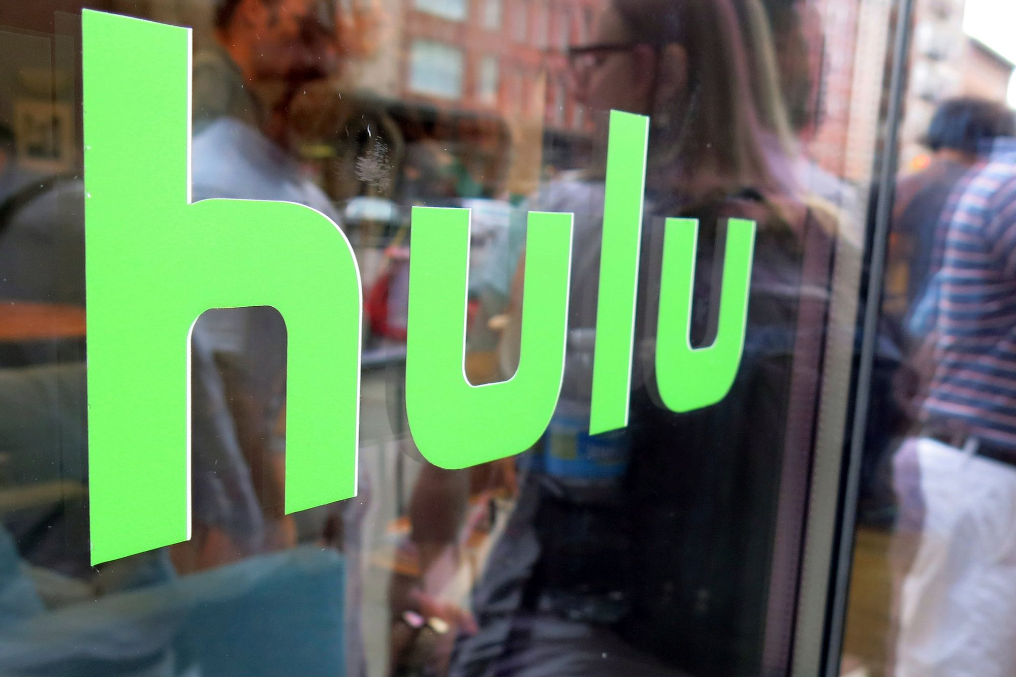 Disney to Buy Comcast's Hulu Stake and Take Full Control of ...