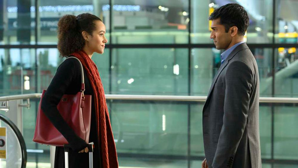 Four Weddings and A Funeral - Episode 101 -- Coming off a devastating heartbreak, Maya travels to London for her best friend Ainsley's wedding. While in town, Maya reconnects with her old college friends, Craig and Duffy, and finds herself thrust into their personal crises.  Maya (Nathalie Emmanuel) and Kash (Nikesh Patel), shown. (Photo by: Jay Maidment/Hulu)