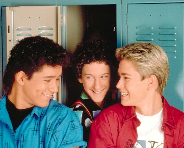 """Dustin Diamond as a teenager, center, with Mario Lopez, left, and Mark-Paul Gosselaar of """"Saved by the Bell,"""" which was a Saturday morning staple."""