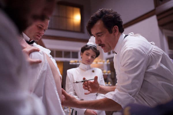 "Clive Owen wields a needle as Eric Johnson and Eve Hewson watch in a scene from ""The Knick."""