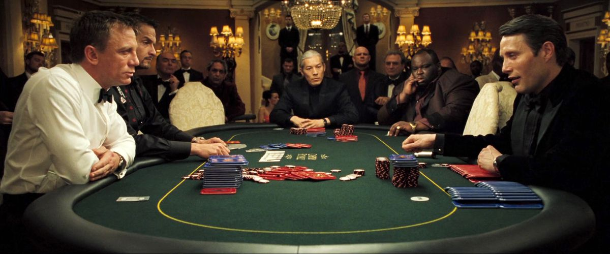 Bond, sweating like a monster, sits opposite Le Chiffre at the poker table in Casino Royale